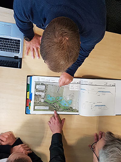 People looking at a map on a desk