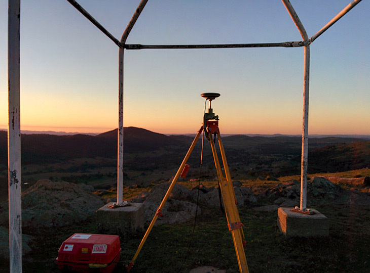 A surveyors trig point setup viewing the sunset