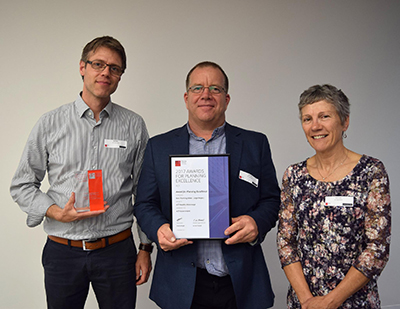 Gus Meijer, Justin Foley and Annie Lane from ACT healthy Waterways receive an award from the Planning Institute of Australia