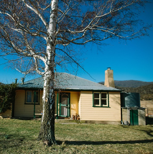 Weatherboard cottage in rural setting